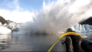 'Lucky to be alive': Kayakers capture harrowing close encounter with collapsing glacier on video