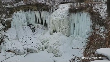 Unbelievable footage shows a completely frozen waterfall