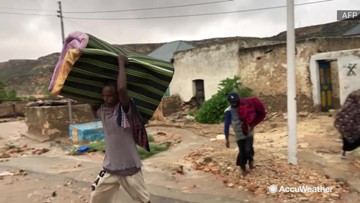 Floodwaters force residents to pack their things and leave