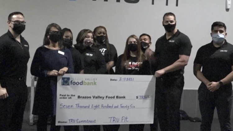 Tru Fit Athletic Clubs make donation to Brazos Valley Food Bank