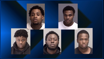 Five charged with organized crime in gun smuggling cases