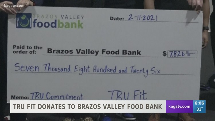 Tru Fit Athletic Clubs donates money to Brazos Valley Foodbank