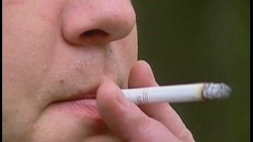 Governor signs bill to raise Texas smoking age to 21