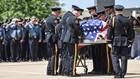Funerals for two Dallas officers killed in ambush