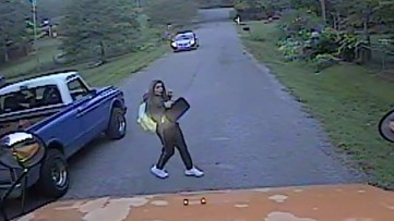 'He just didn't care': Video shows girl's frightening brush with truck running school bus stop sign